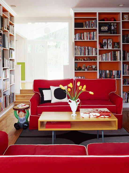 Red and orange living room with built-in shelves