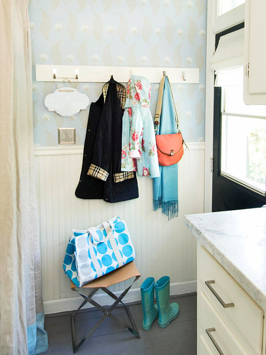 Simple wall hooks create a mudroom out of a small entry