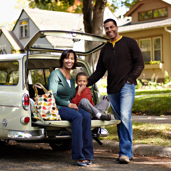 Family sitting in back of vehicle