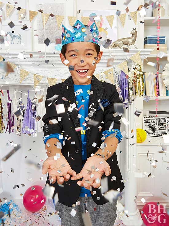 New Year's Eve party boy with confetti