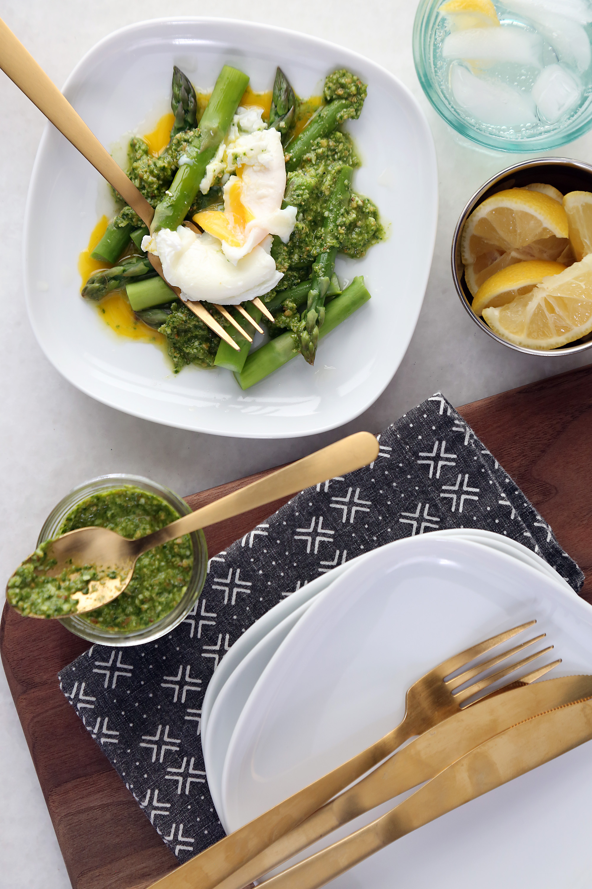 Asparagus and Poached Eggs with Spinach Pesto white plate on table
