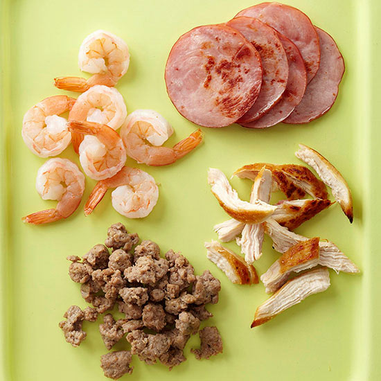 Sausage, chicken, Canadian bacon, and shrimp on tray
