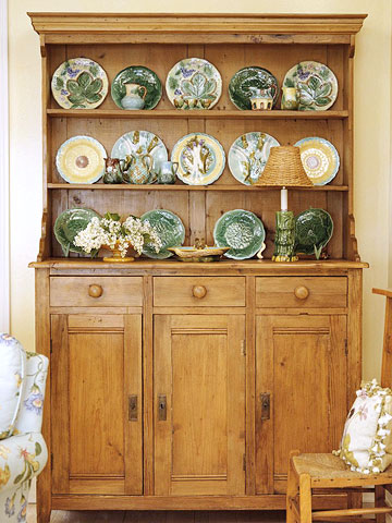 Green plates in pine hutch