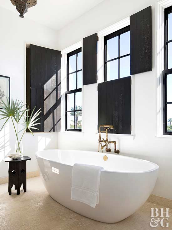 monochromatic bath with black window shutters