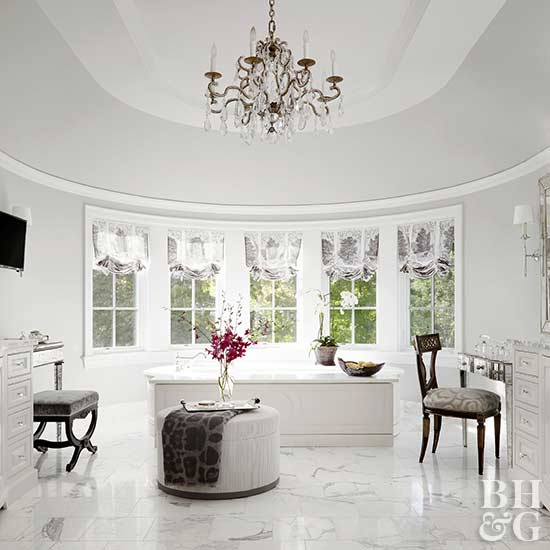 large white upscale bath with chandelier