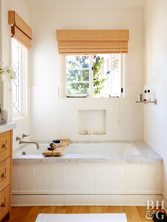 neutral tiled bath with natural accents