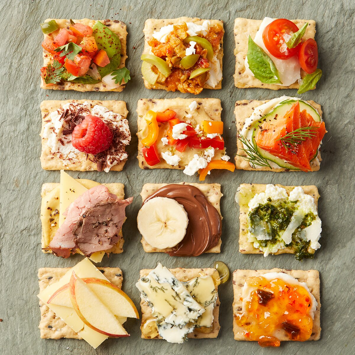twelve crackers with toppings