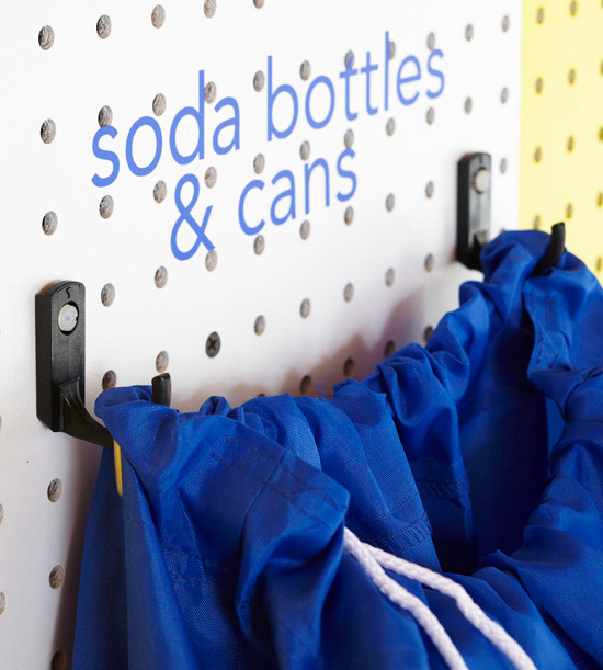 Close-up of bottle and cans pegboard area