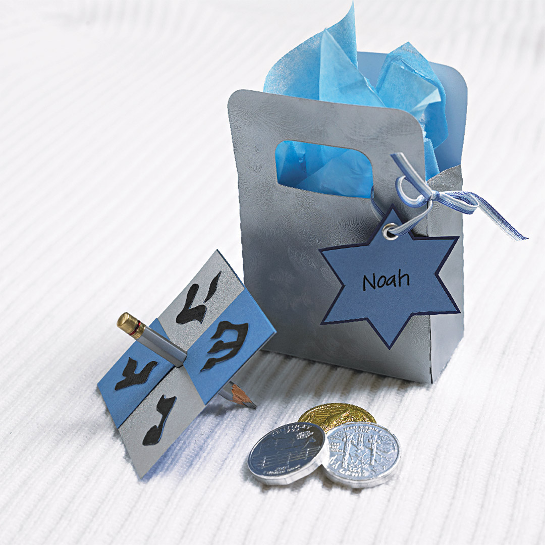 hanukkah gift bag with gold coins and dreidel
