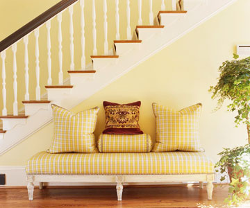 yellow hallway with padded bench