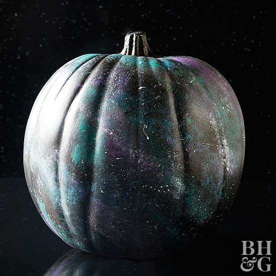 black purple and blue painted pumpkin with white speckles