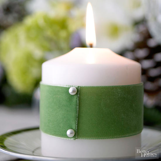 green ribbon wrapped around candle