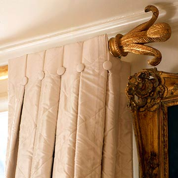 ColorMar05_Detail of beige curtain and ornate antique gold curtain rod