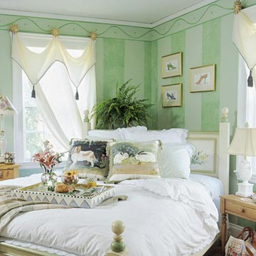 green striped and decorated walls with shear curtains