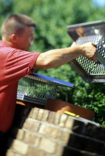 man cleaning filters