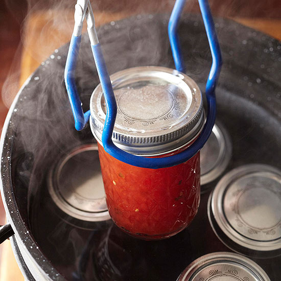 Removing canning jar from canner