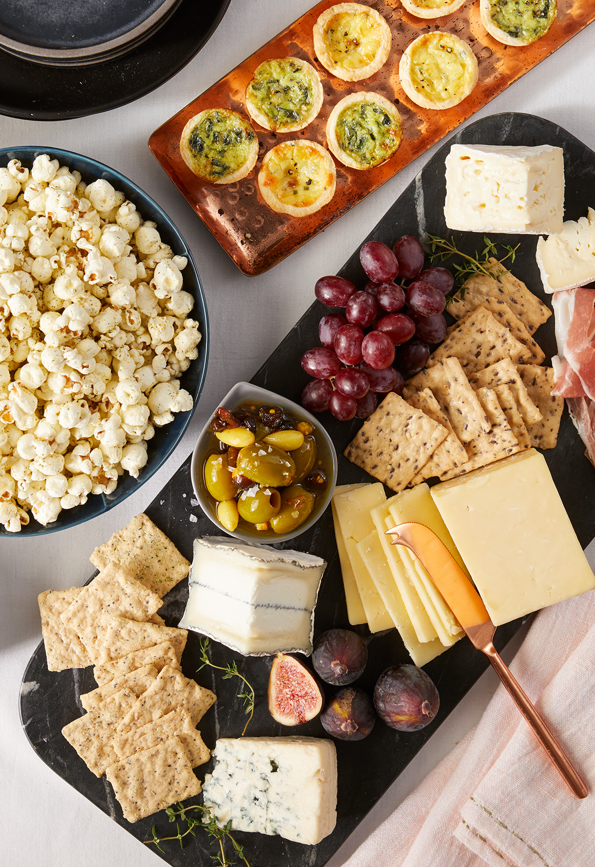 close-up party table with popcorn and charcuterie board