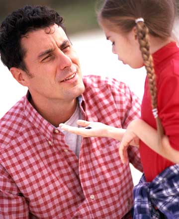 Father talking to young daughter