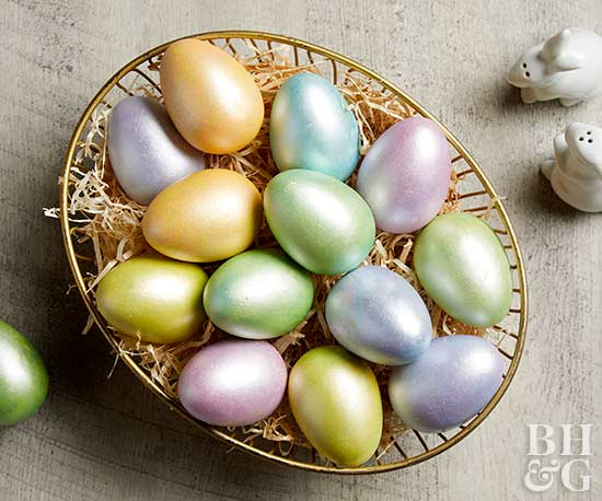 pastel metallic eggs in basket