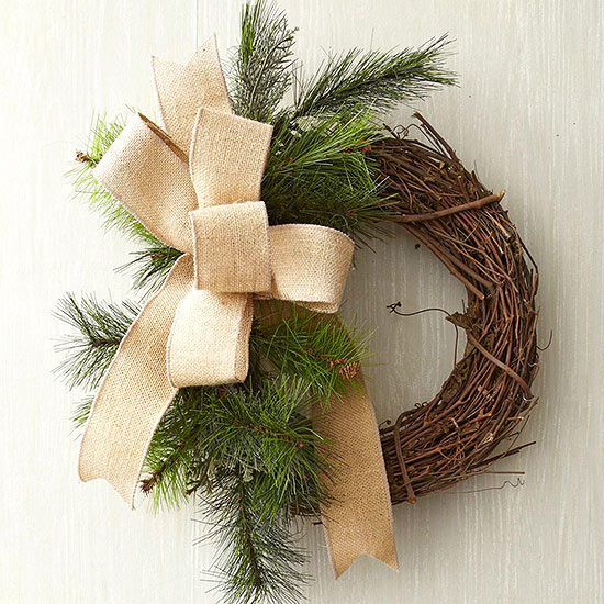 adding burlap bow to purchased grapevine wreath