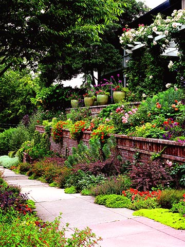 twocolor_Two Tiered Greenery and Flowers Lining Sidewalk