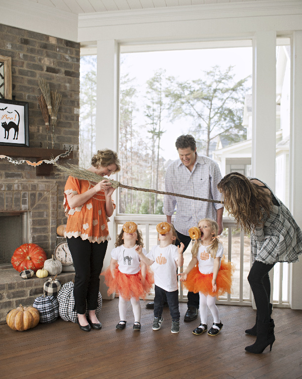 Family playing Halloween party games