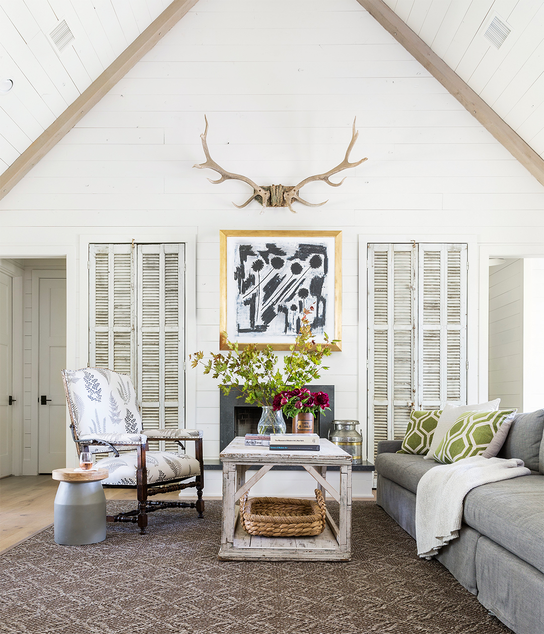 living room with antlers hanging above fireplace