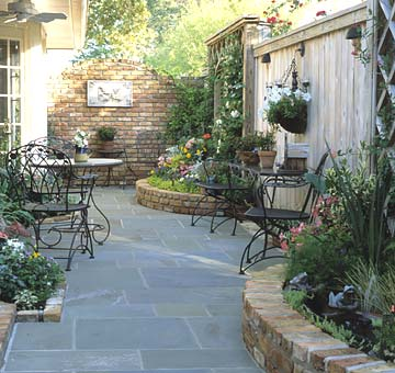 Shady courtyard with curved planter