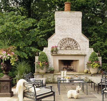 Patio with large stone fireplace