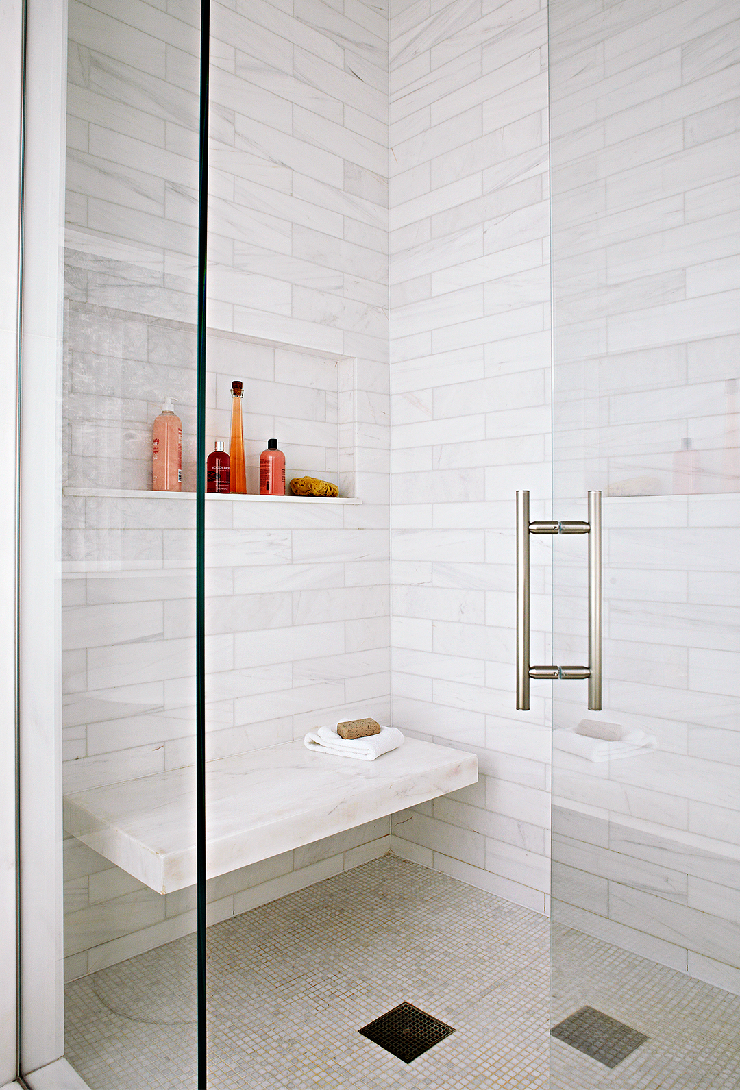 walk in shower white tiles with bench and shelf