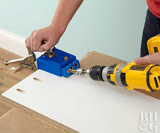making a coffee table drilling screws step