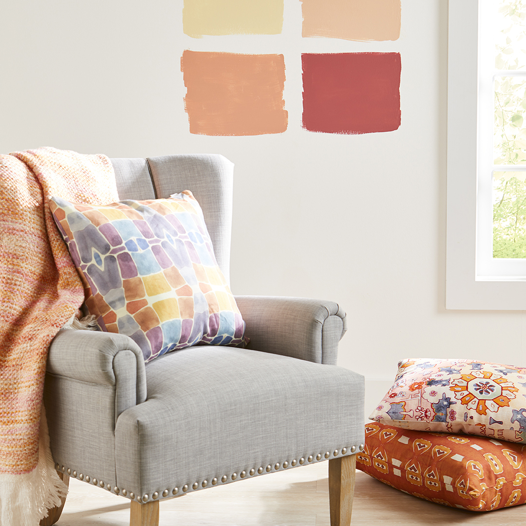 grey chair with throw paint samples