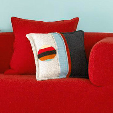 Felted throw pillow on couch
