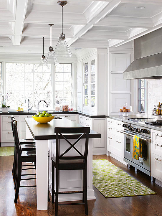 kitchen with white cabinetry stainless steel appliances and hardwood floors