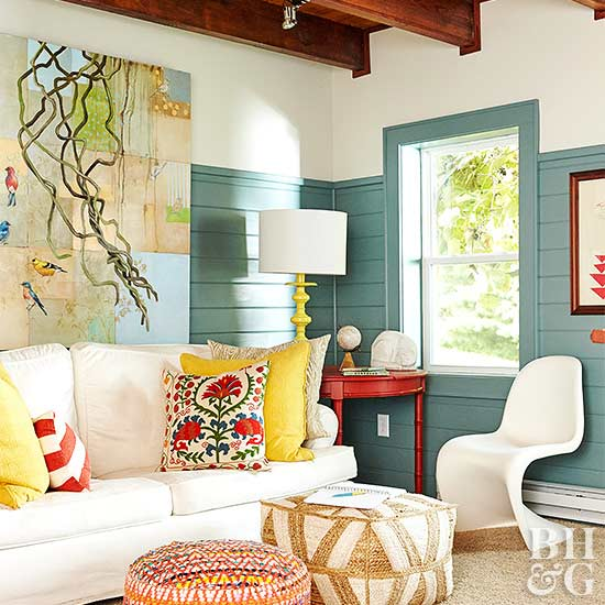 Exposed beams, wood ceiling, wainscoting, cantilever chair, accent pillows, white sofa, abstract artwork
