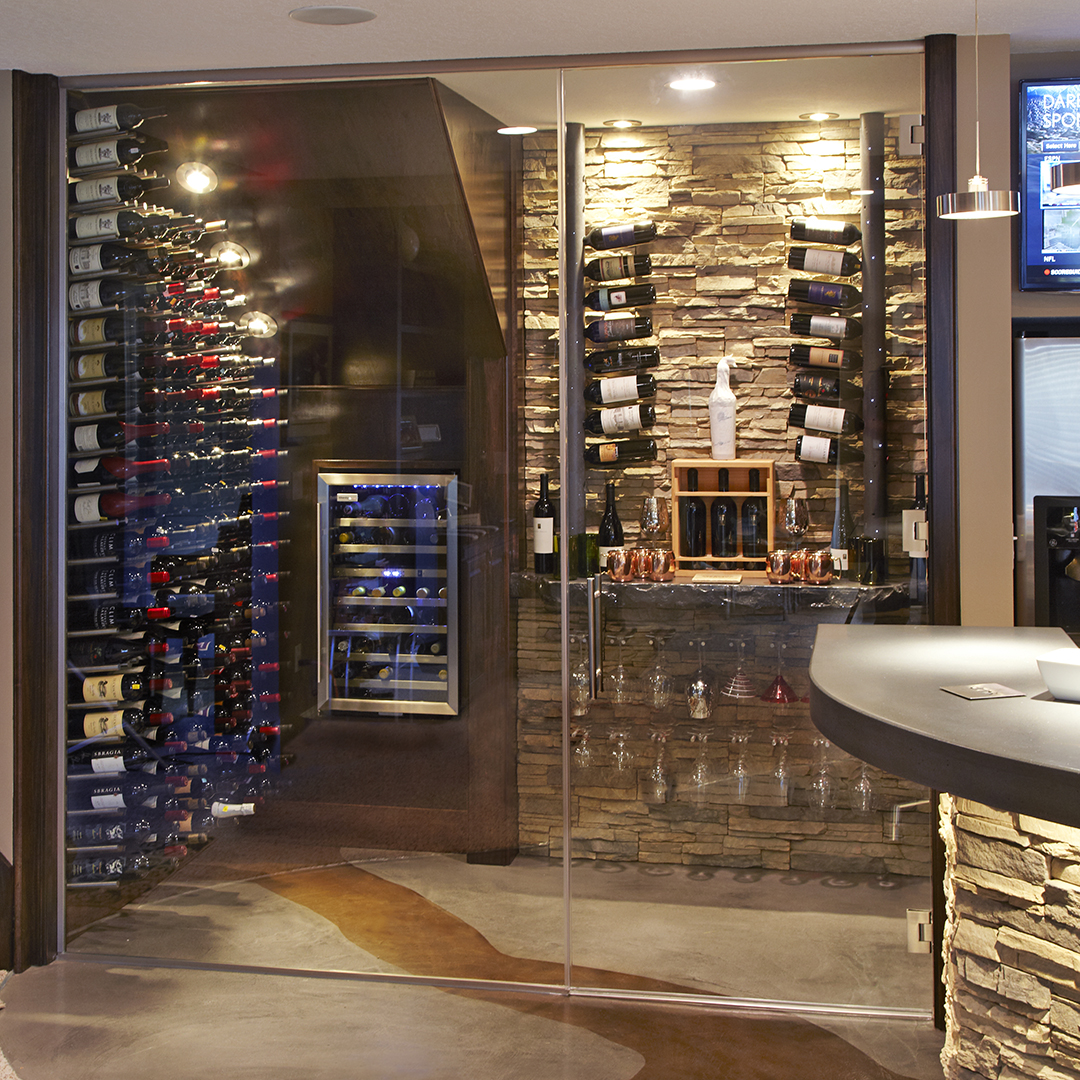 basement with wet bar and glass wine cellar