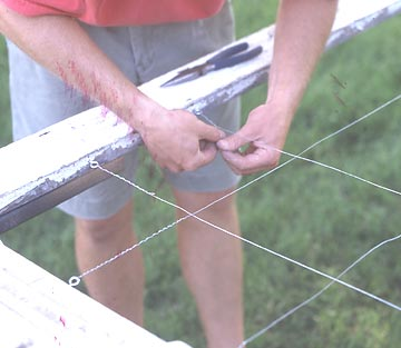 Adding wire to a window frame trellis during construction