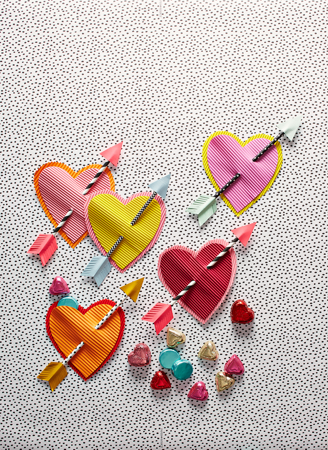 heart shaped valentines day cards on polkadot background