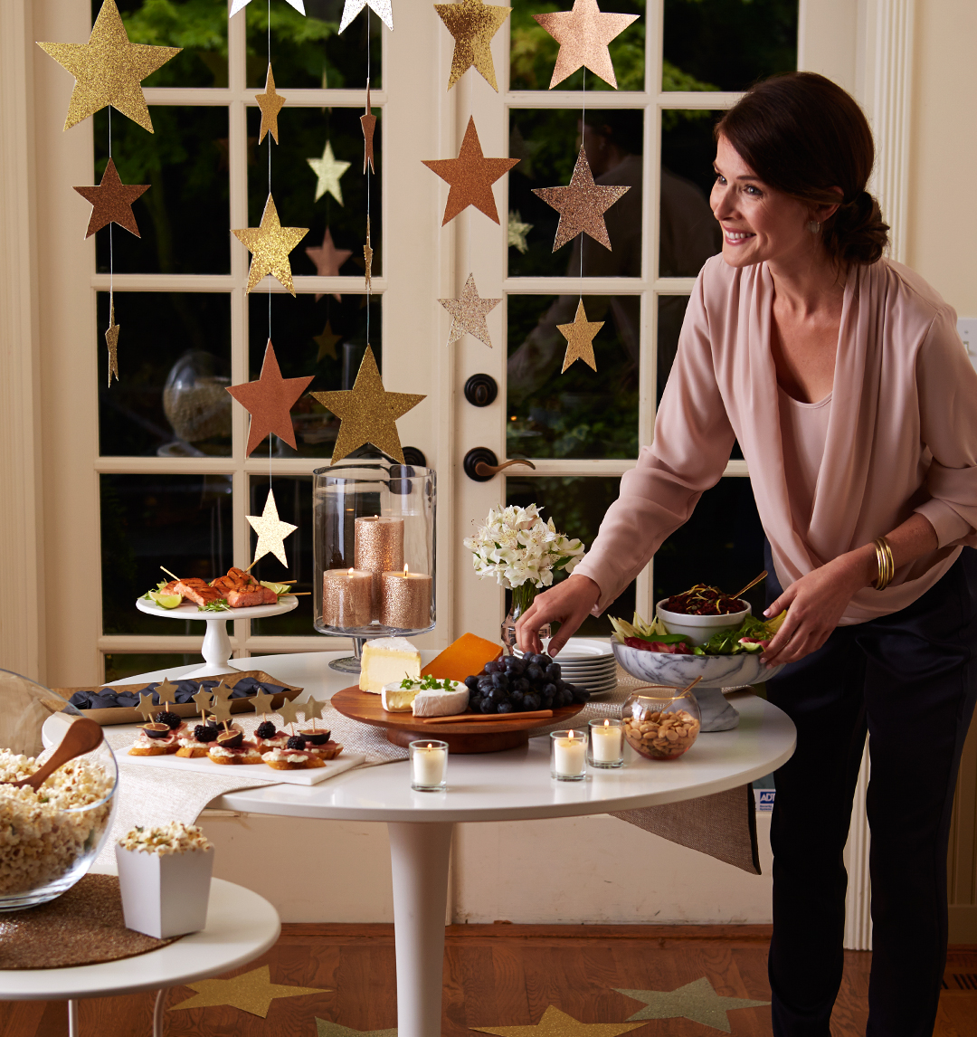 oscar party decorations with food on table and hanging stars