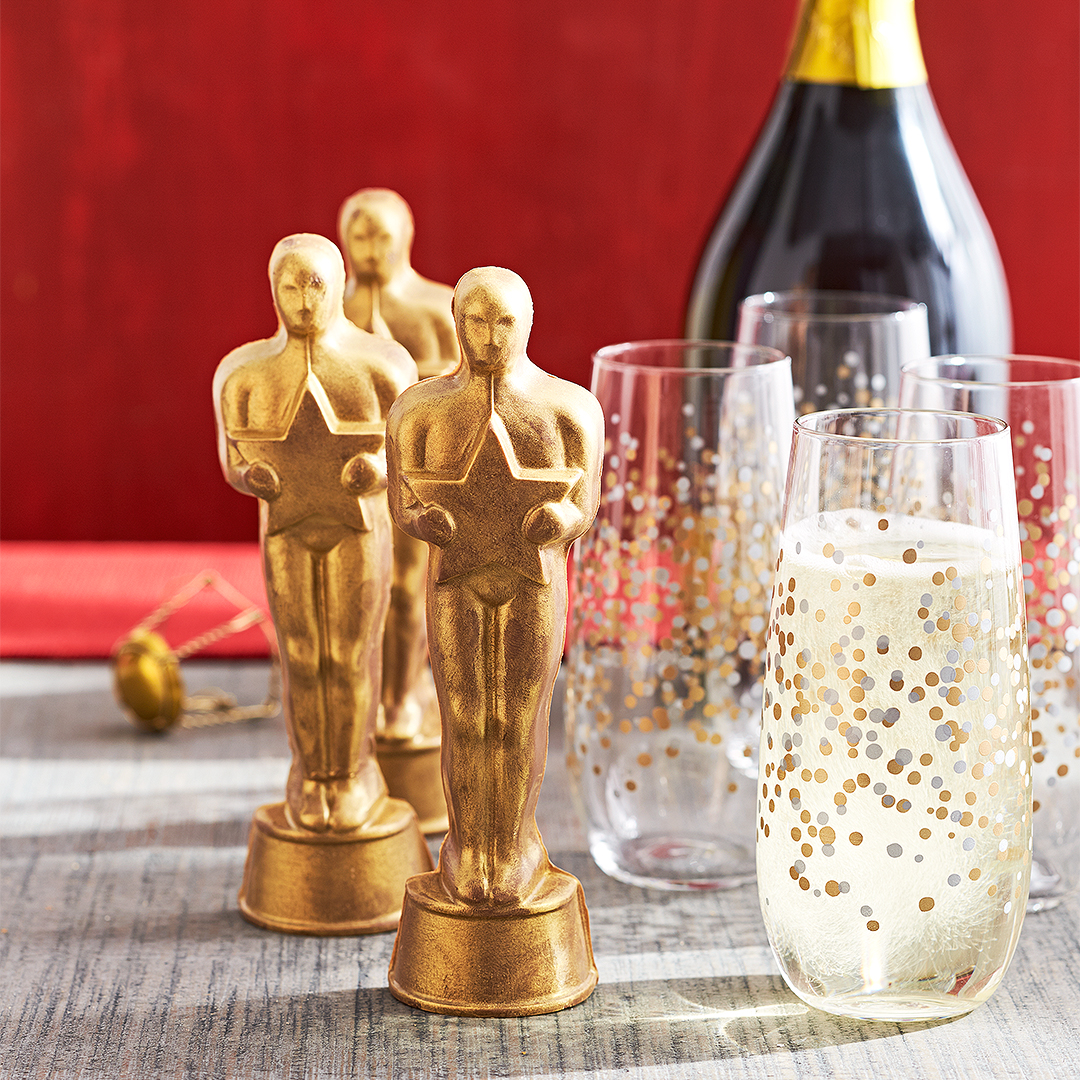 oscar statues and champagne with metallic spotted glasses