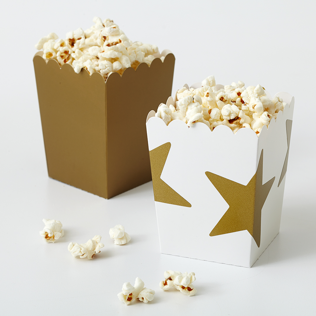 popcorn in gold decorative boxes with stars