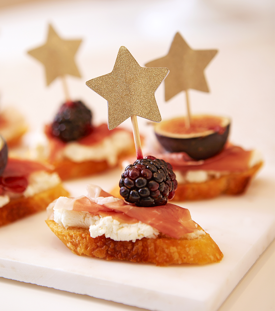 bruchetta appetizers on cutting board with stars garnish