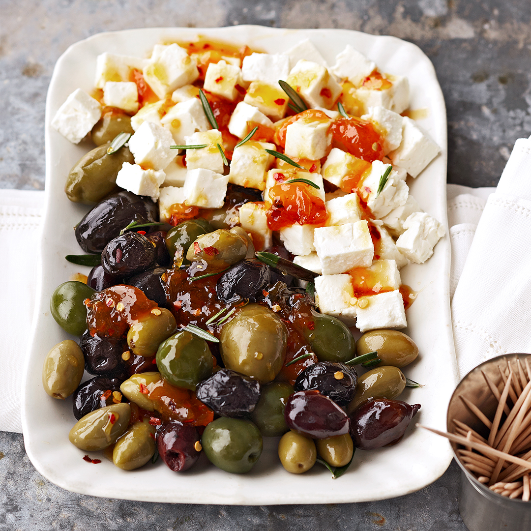 Olive Medley recipe on white rectangular plate with tootpicks