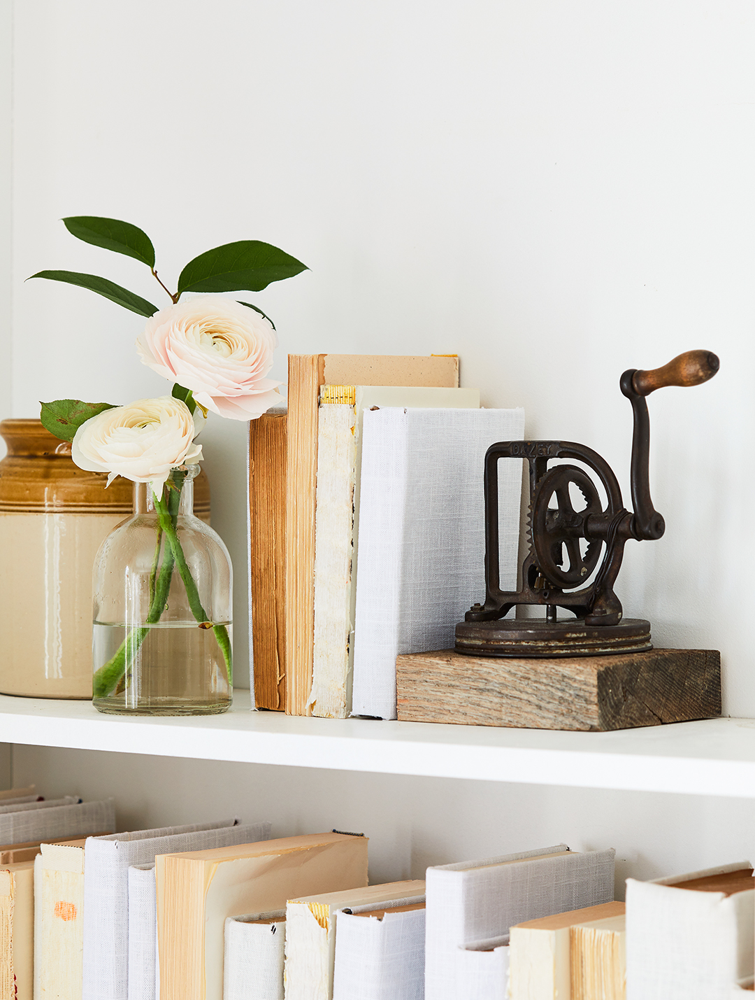 shelving unit with butter churn bookend