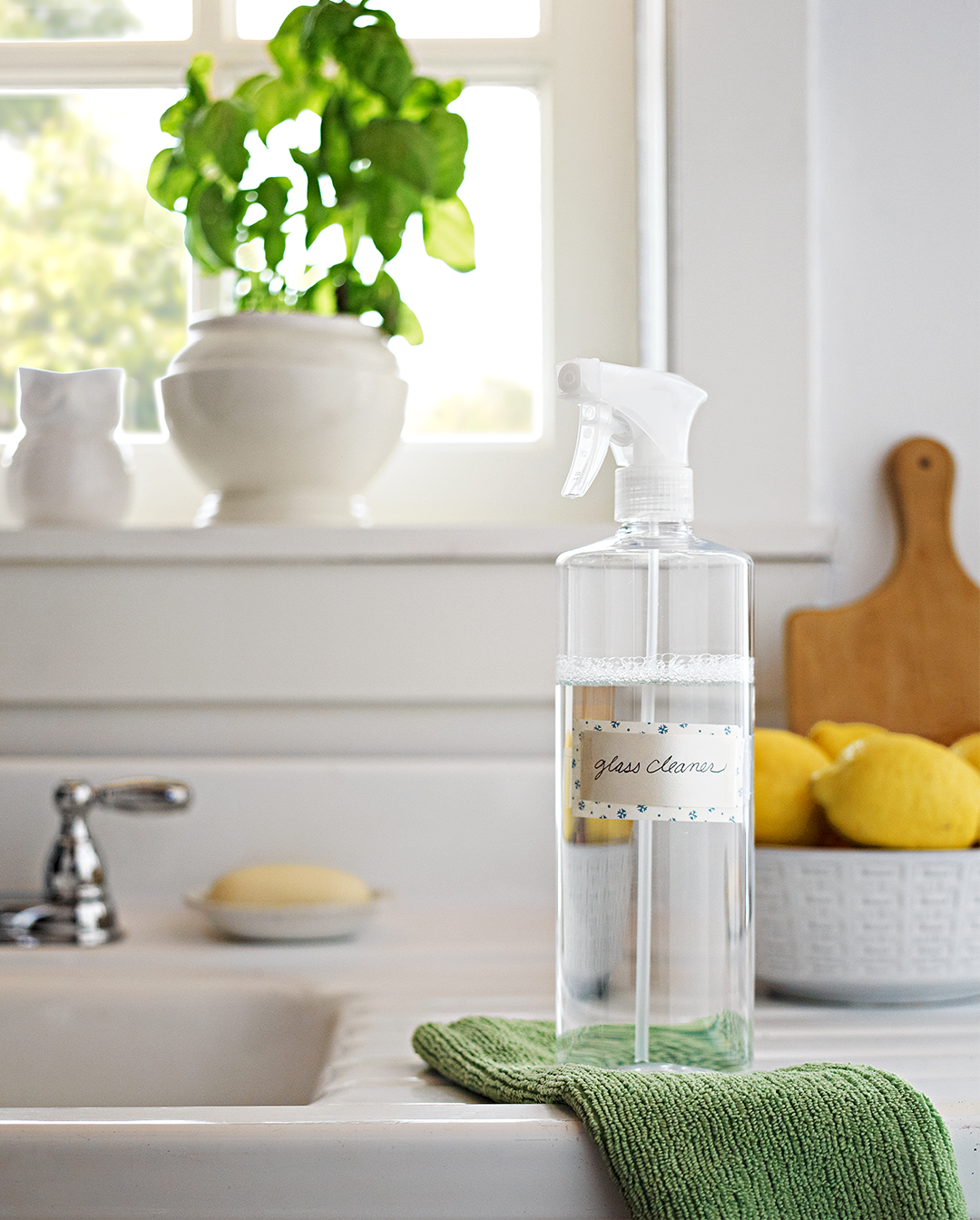 homemade glass cleaner on counter kitchen sink window