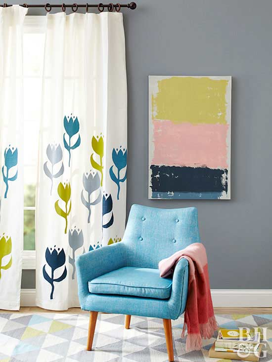 colorful rug, white curtains, paint, blue chair