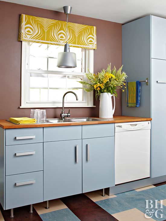 blue-gray kitchen cabinets and yellow window valance