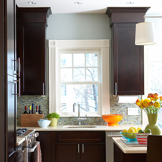 dark wood kitchen cabinets with molding