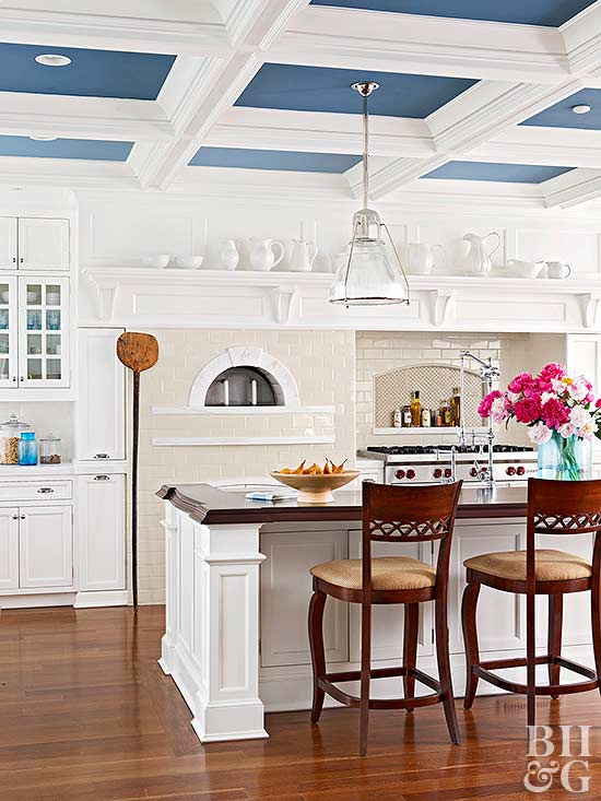 kitchen with white cabinets and blue ceiling