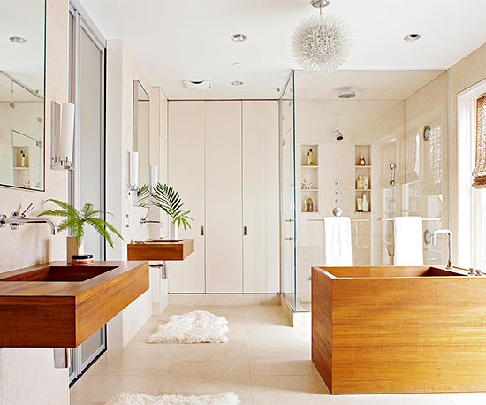 bright modern bath with wood tones and floating sinks